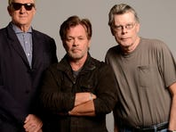 T Bone Burnett, John Mellencamp, Stephen King (l-r).  the Stephen King/John Mellencamp musical.  John Mellencamp, Stephen King and T-Bone Burnett have opted for a novel approach to getting their new musical more exposure. They are taking the show, Ghost Brothers of Darkland County, on the road -- as a concert.    Photo by Kevin Mazur