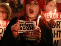 Demonstrators hold placards and candles in memory of Indian Savita Halappanavar in support of legislative change on abortion during a march from the Garden of Remembrance to the Dail (Irish Parliament) in Dublin, on Nov. 17, 2012.