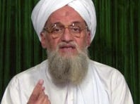 This photo taken from a video provided by the SITE Intelligence Group on Feb. 12, 2012,  shows al-Qaeda's chief Ayman al-Zawahiri at an undisclosed location making an announcement in a video-relayed audio message posted on jihadist forums.
