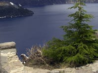 Tourists take in the view at Crater Lake National Park, Ore., in 2006. Remnants of a wagon road that opened in 1865 can be seen in the park.