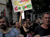 A man holds a placard during a demonstration against the Eurovegas project  on June 25, 2012.