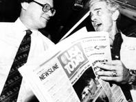 Al Neuharth, right, chairman and president of Gannett, looks over the first copy of USA TODAY.
