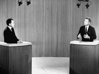 Sen. John F. Kennedy, D-Mass., right, speaks and Vice President Richard M. Nixon listens during the fourth presidential debate from a New York studio.