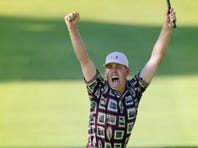 Justin Leonard celebrates holing a long birdie putt on the 17th green that clinched a U.S. win in the 1999 Ryder Cup.