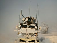 An MRAP vehicle clears the road around Kop Ahmed camp near Kandahar city in Afghanistan.