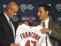 Indians general manager Chris Antonetti, right, presents new manager Terry Francona with a jersey during a news conference at Progressive Field.