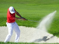 Jonas Blixt of Sweden plays out of a bunker on the ninth hole Sunday on his way to victory in the Frys.com Open.