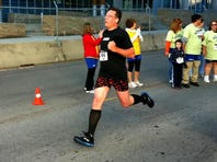 Brian Mansfield approaches the finish line of the Colon Cancer Alliance's Undy 5000 run on Oct. 20 in Nashville.