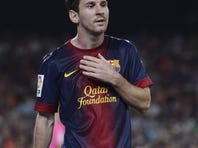 FC Barcelona's Lionel Messi from Argentina looks on against Granada during the Spanish La Liga soccer match at the Camp Nou stadium in Barcelona, Spain, Saturday, Sept. 22, 2012.
