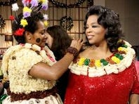 Oprah Winfrey with student from The Conservatorium of Music in Fiji during the October taping of 'Oprah's Favorite Things: 2012.'