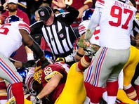 Giants DT Linval Joseph yanks Redskins C Will Montgomery's (63) leg Monday night.