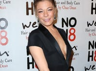 LeAnn Rimes' down-to-the-navel neckline gave photogs an eyeful when she leaned over on the red carpet Dec. 12 at an event in Hollywood.
