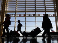Travelers walk through a terminal at Ronald Reagan National Airport near Washington, D.C.