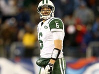Jets quarterback Mark Sanchez sacked in the second quarter during their loss to the Titans on Monday night at LP Field.