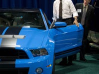 President Obama gets inside a Ford Mustang Shelby GT500 as he tours Washington's 2012 Auto Show on Jan. 31.