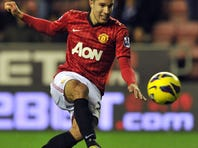 Manchester United's Dutch striker Robin Van Persie scores the team's fourth goal during the English Premier League match against Wigan Athletic in Wigan, England on Tuesday.