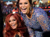 """Nicole """"Snooki"""" Polizzi, left, and  Jenni """"JWOWW"""" Farley have a good laugh as they  appear on 'MTV's Club NYE 2013.'"""