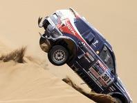Stephane Peterhansel, competing here in 2010, has won 10 Dakar Rally titles.