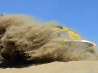 Regis Delahaye and co-pilot Alexandre Winocq of team Buggy MD Rallye compete during the second stage of the Dakar Rally.