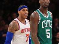 Carmelo Anthony and Kevin Garnett before their postgame encounter.