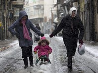 Snow blankets the Middle East