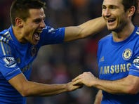 Chelsea's Cesar Azpilicueta and Frank Lampard celebrate after Stoke City's second own-goal.
