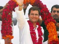 Rahul Gandhi waves to the crowd as he is during a 2009 election rally in Amethi, India.