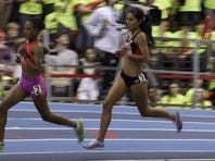 Tirunesh Dibaba, left, of Ethiopia, leads the field during the early laps of the women's two-mile race at the Boston Indoor Grand Prix. Dibaba won the race.