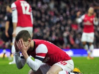Arsenal's English midfielder Jack Wilshere reacts after missing a chance in the last few seconds in a loss to Blackburn in the fifth round of the FA Cup.