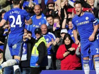 Chelsea's John Terry celebrates after scoring the team's fourth goal  during the fourth round replay English FA Cup match between Chelsea and Brentford at Stamford Bridge in London.