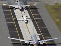 In this file photo from Sept. 8, 2008, planes taxi to a runway at John F. Kennedy International Airport in New York.