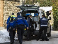 Police investigate at the site of a deadly shooting at a wood-processing company in Daillon, Switzerland, on Thursday.