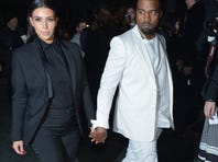 Kim Kardashian and Kanye West attend the Givenchy  Fall/Winter 2013 Ready-to-Wear show as part of Paris Fashion Week on March 3, 2013 in Paris.