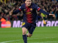 Barcelona's forward Lionel Messi, from Argentina, celebrates after scoring their second goal during the Champions League round of 16 second leg soccer match between FC Barcelona and AC Milan at Camp Nou stadium, in Barcelona, Spain, Tuesday, March 12, 2013.