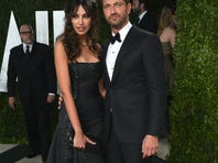 Gerard Butler and model Madalina Ghenea arrive at the 2013 Vanity Fair Oscar Party hosted by Graydon Carter at Sunset Tower on Feb. 24.