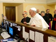 Pope Francis pays the bill at the Domus Internationalis Paulus VI hotel, where he stayed as a cardinal before entering the conclave.