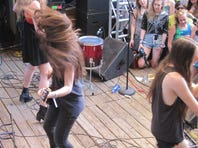 The band Haim playing the Filter Magazine Showdown on Cedar St. on Friday during South By Southwest in Austin, Tex. Left to right, Este (facing crowd), Danielle (facing back) and Alana.