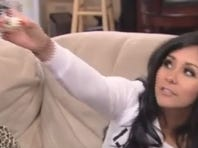 Snooki toasts her pals before drinking her own breast milk shot.