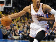 Oklahoma City Thunder guard Russell Westbrook (0) handles the ball against Portland Trailblazers guard Wesley Matthews (2) during the second half at Chesapeake Energy Arena.