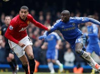 Chelsea's Demba Ba, right, competes with Manchester United's Chris Smalling during their English FA Cup quarterfinal match at Stamford Bridge, London, Monday.
