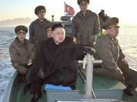 North Korean leader Kim Jong Un rides on a boat near the western sea border with South Korea on March 11.