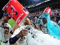 Justin and B.J. Upton both homered in the ninth inning and then got Gatorade showers in a postgame interview.
