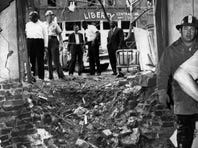 A large crater left by a bomb that exploded near a basement room of the Sixteenth Street Baptist Church in Birmingham, Ala., is shown in this September 15, 1963, photo. The explosion killed four young girls.