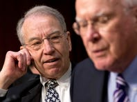 Sen. Chuck Grassley, ranking Republican member on the Senate Judiciary Committee, left, pauses after a  heated exchange Monday during the committee's hearing on immigration reform. Committee Chairman Patrick Leahy, D-Vt. is at right.