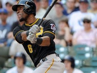 Starling Marte hits a 2-run home run in the 8th inning to tie the game against the Brewers.