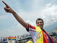 Venezuelan opposition candidate, Henrique Capriles Radonski, gestures during  a campaign rally in Merida, Venezuela on April 10.