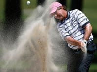Gene Sauers hits a bunker shot on the tenth hole during the second round of the Insperity Championship.