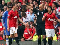 Rafael Da Silva of Manchester United is sent off by referee Howard Webb during the Barclays Premier League match against Chelsea at Old Trafford on Sunday in Manchester, England.
