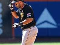 Pedro Alvarez of the Pittsburgh Pirates celebrates after his game-winning hit in the eighth inning Sunday.