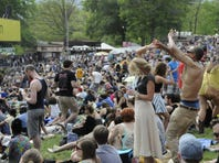 Fans dance and sing along to Passion Pit at the Sweetlife Festival on May 11.